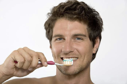Man using fluoride toothpaste